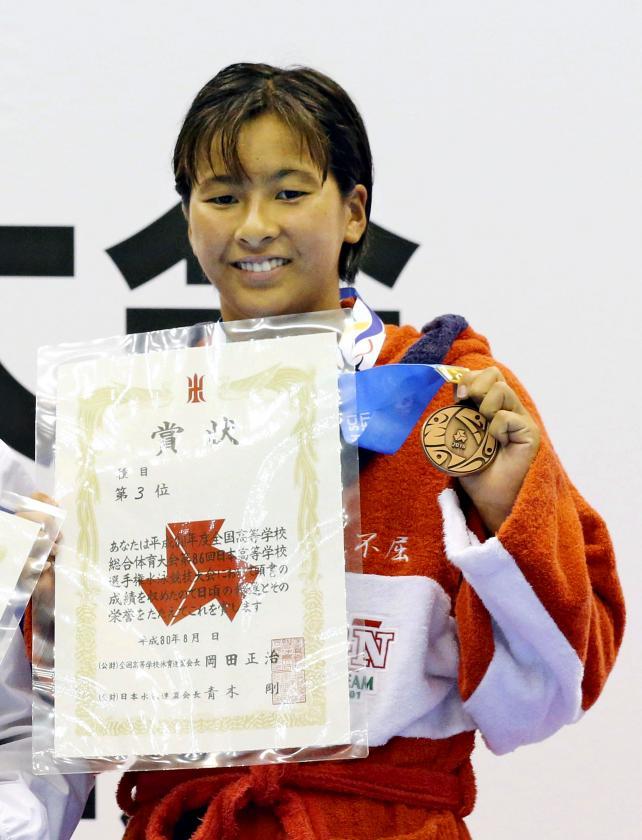 競泳女子100メートル背泳ぎで3位になった京都外大西の又木愛紗 ©読売新聞社